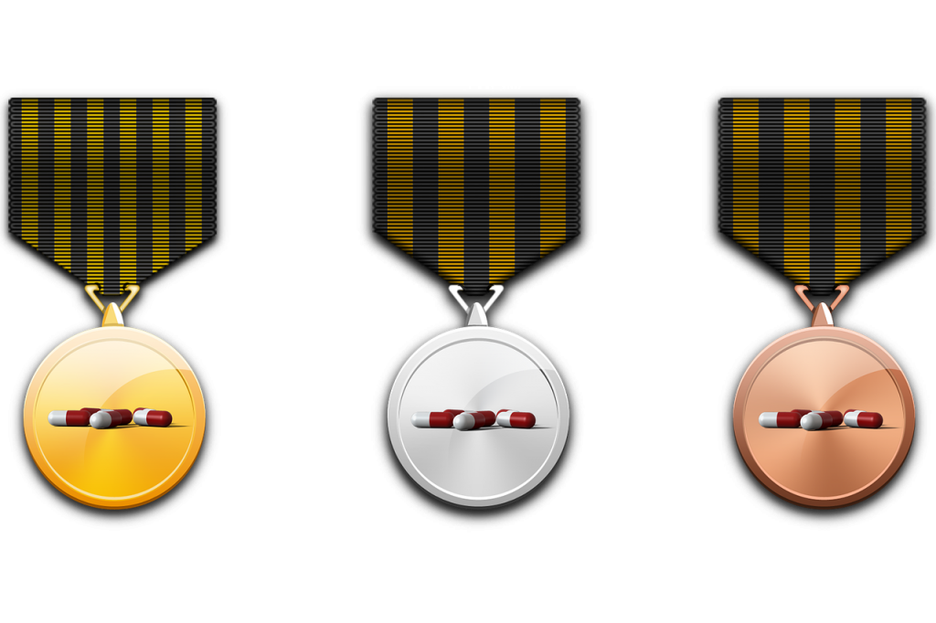 different metals, one gold, one bronze, and one silver with pills in the center of them