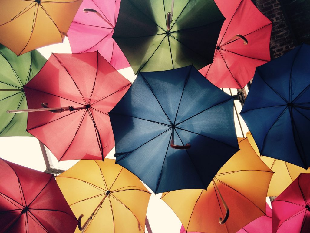 a cluster of opened colorful umbrellas